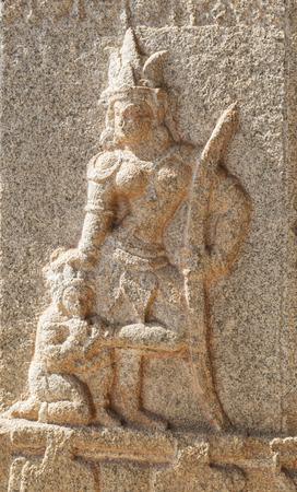 寺の柱にハンピの Ram basrelief 像 写真素材