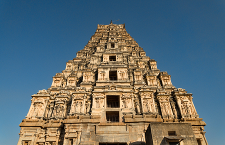 Hindu temple tower in Hampi view from below