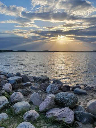 The colorful sunset over the Minsk sea, Belarus. HDR-photo 免版税图像