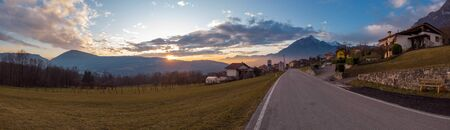 The Sunset road to Alpine Village. Arsie, province of Belluno, Italy
