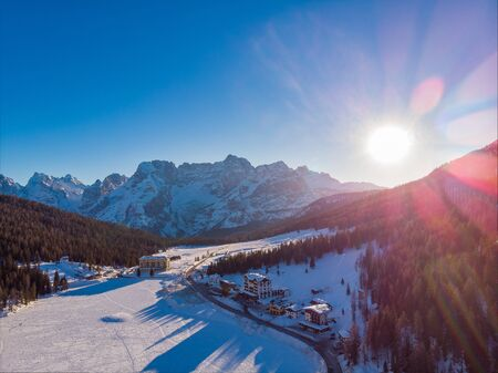 The sunset view of the frozen lake Misurina and Dolomites, Italy. Drone aerial shots