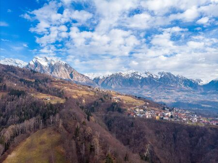 The view of the Dolomites Alps and the village, province Belluno, Italy Imagens