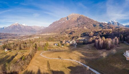 Morning in the alpine village Mazzucchi, Italy. Drone aerial panorama