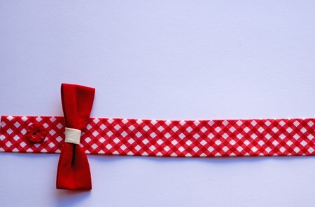 red cotton tape with bow - horizontal