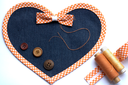 stitched heart of denim with bow