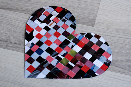 Mosaic of paper n the shape of heart - copy space