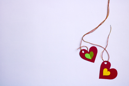 Two hearts,with two small inside - a bright gray background Stock Photo