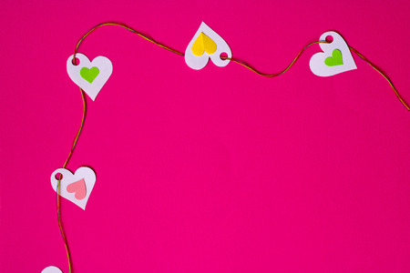 affairs: Hearts in a row,  top-left corner, pink background Stock Photo