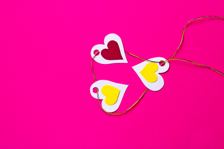 abstrakt: Three paper hearts on a pink background, copy space Stock Photo