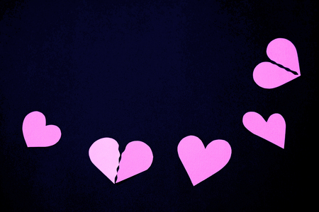 cut paper: Various form paper hearts - black background Stock Photo