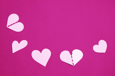 cut paper: Gentle pink hearts on a purple background - copy space