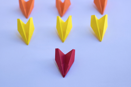 common goal: Paper planes - business concept, solid leadership