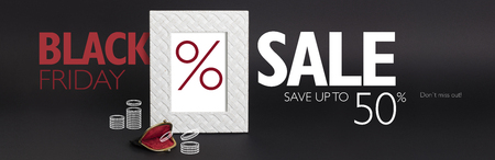 Black Friday discount banner. White photo-frame on a black background, with a vintage woman's wallet in front of it.