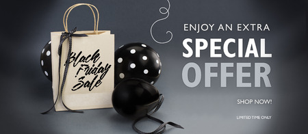 Black Friday sale banner containing recycled paper bag decorated with black satin ribbon, and black balloons. Grey background.