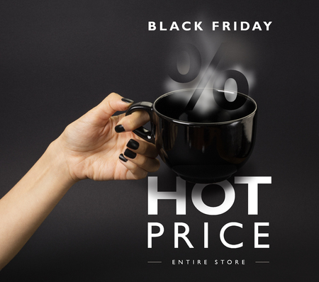 Banner for Black Friday sale - female hand with black nails holding a big, black, steaming cup. Black background.
