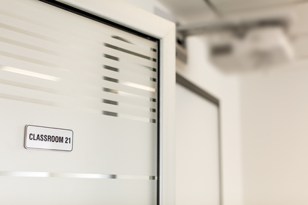 Modern classroom doors with number plate.
