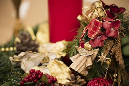 Christmas composition: Details on yule wreath – mistletoe, angel, Christmas  greens.