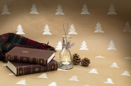 Christmas composition – candleholder, books and blanket.