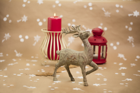 Christmas holiday composition. Wooden deer figurine in front plan.