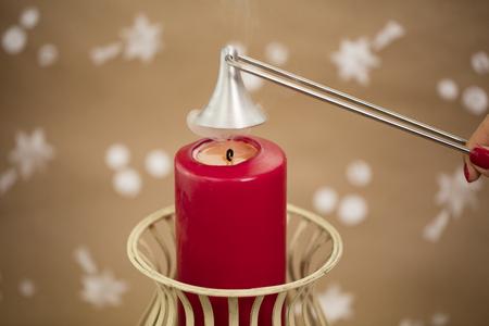 Red candle, freshly extinguished. Christmas atmosphere. 版權商用圖片