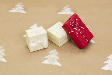 Christmas composition – gift boxes on handmade background.