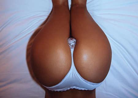 Beautiful female ass, in underwear, bed