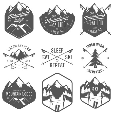 mountain skier: Set of vintage skiing labels and design elements