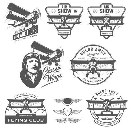 biplane: Set of vintage biplane emblems, badges and design elements