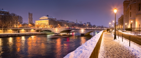 Quayside along River Seine under snow