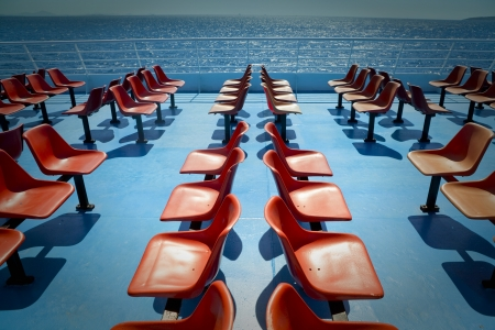Empty chairs on the upper deck of a ferry boat on Aegean Sea in Greece Stock Photo - 19445744
