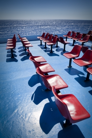 Empty chairs on the upper deck of a ferry boat on Aegean Sea in Greece Stock Photo - 19445472