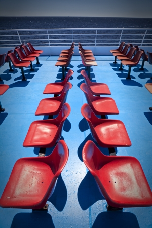 Empty chairs on the upper deck of a ferry boat on Aegean Sea in Greece Stock Photo - 19445748