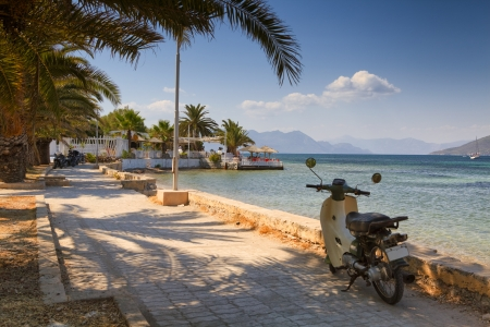 peloponnese: Parked scooter in Aegina, Greece Stock Photo