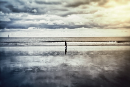 basque woman: Lonely silhouette walking on a beach at low tiude