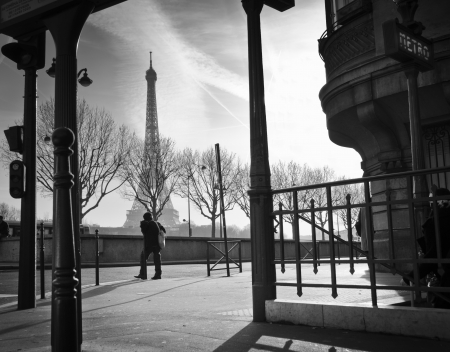 Silhouette on a sidewalk and Eiffel Tower in Paris, France