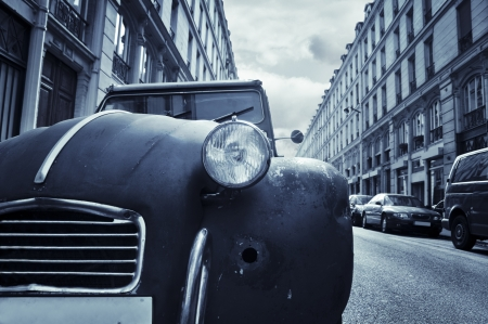 tinted: Old car in a street in Paris, France