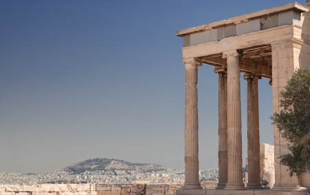 Part of Erechteion on the Acropolis and Athens skyline in Greece Stock Photo
