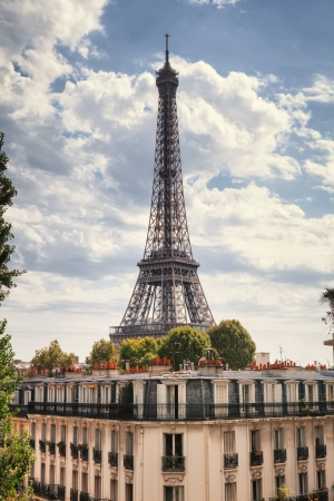 Eiffel Tower and old buildings in Paris, France Stock Photo