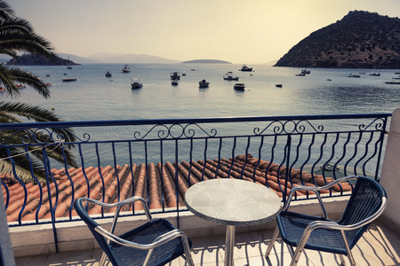 Hotel terrace with sea view in Tolo, Greece