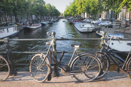 netherlands: Bike and a bridge in Amsterdam, Netherlands Stock Photo
