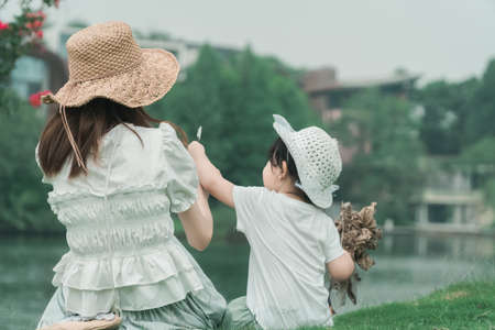 Chinese family playing outdoors, mother and daughter playing in Luhu Lake in Chengdu, Sichuan