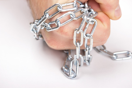 the chain coiled up on a hand Stock Photo