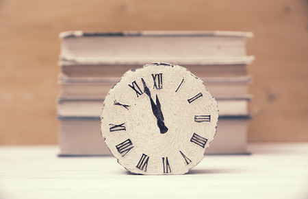 clock and stack of books