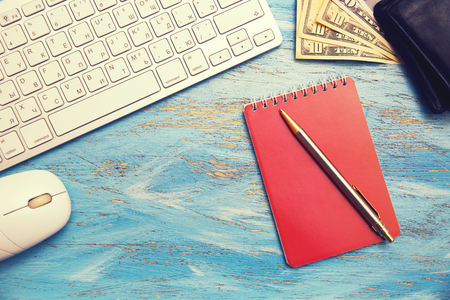 keyboard, notebook and money