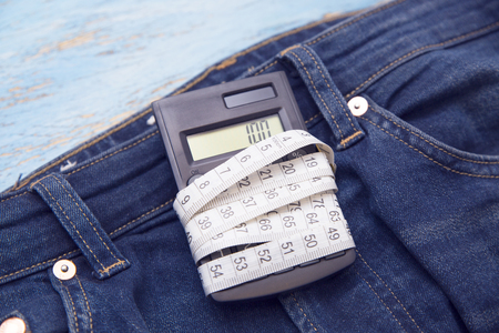 master volume: overweight, jeans, ruler, calculator