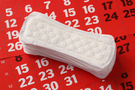 The sanitary product lying on a red calendar. Stock Photo