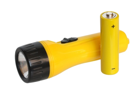 torchlight: Flashlight and batteries on a white background.