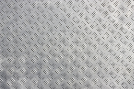 A background of metal diamond plate.