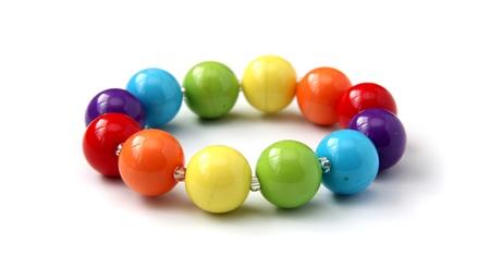 Color beads close up on a white background. Foto de archivo