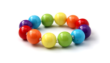 Color beads close up on a white background. Stock Photo